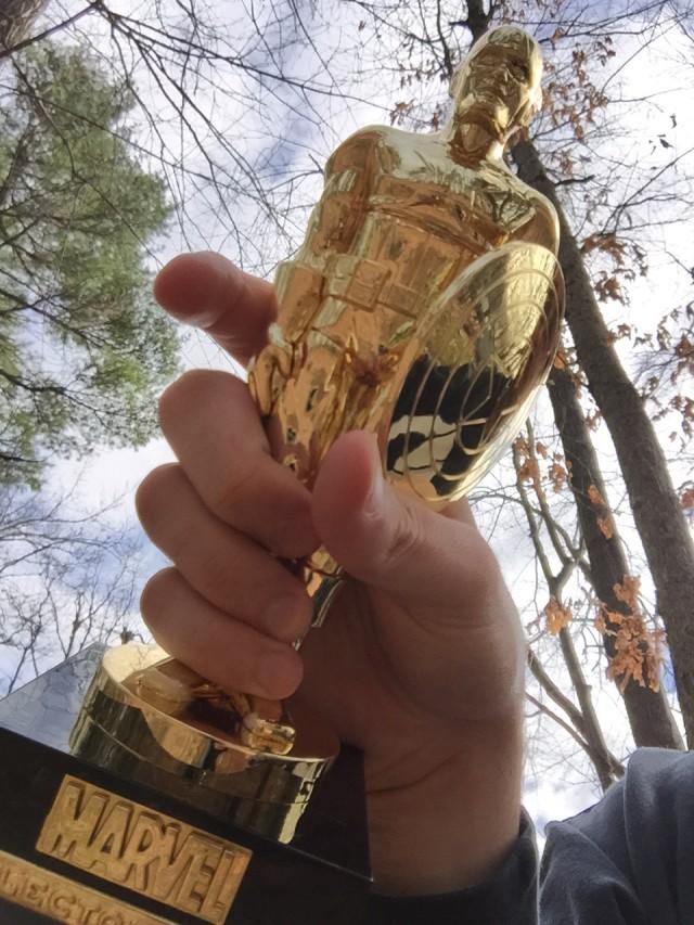 Dabid Holding Funko Gold Chrome Captain America Statue