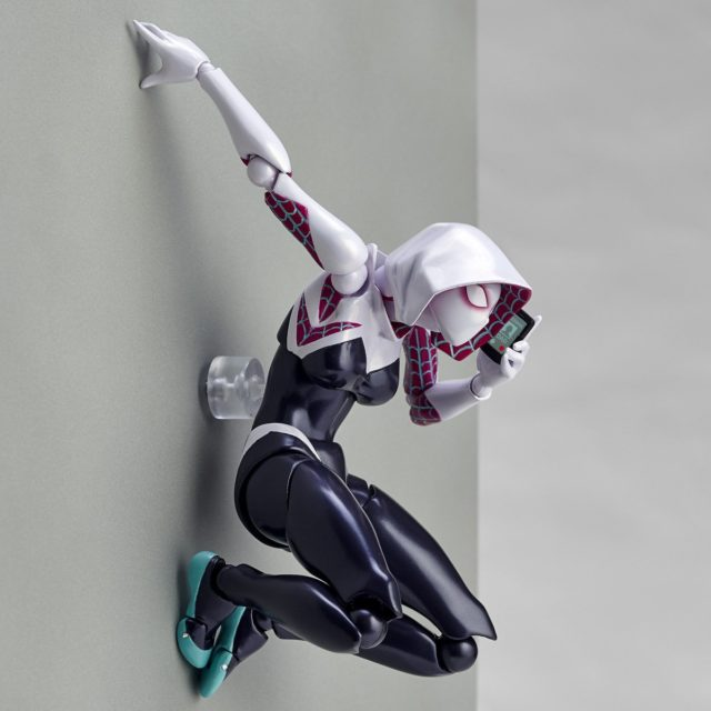 Amazing Yamaguchi Spider-Gwen Figure on Wall Talking on Cell Phone