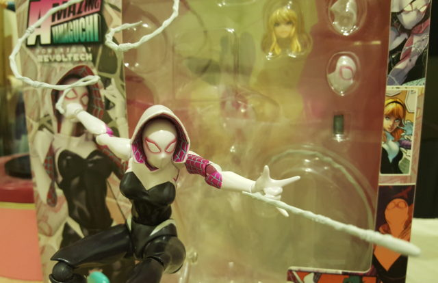 Kaiyodo Revoltech Spider-Gwen Figure Swinging In Front of Box