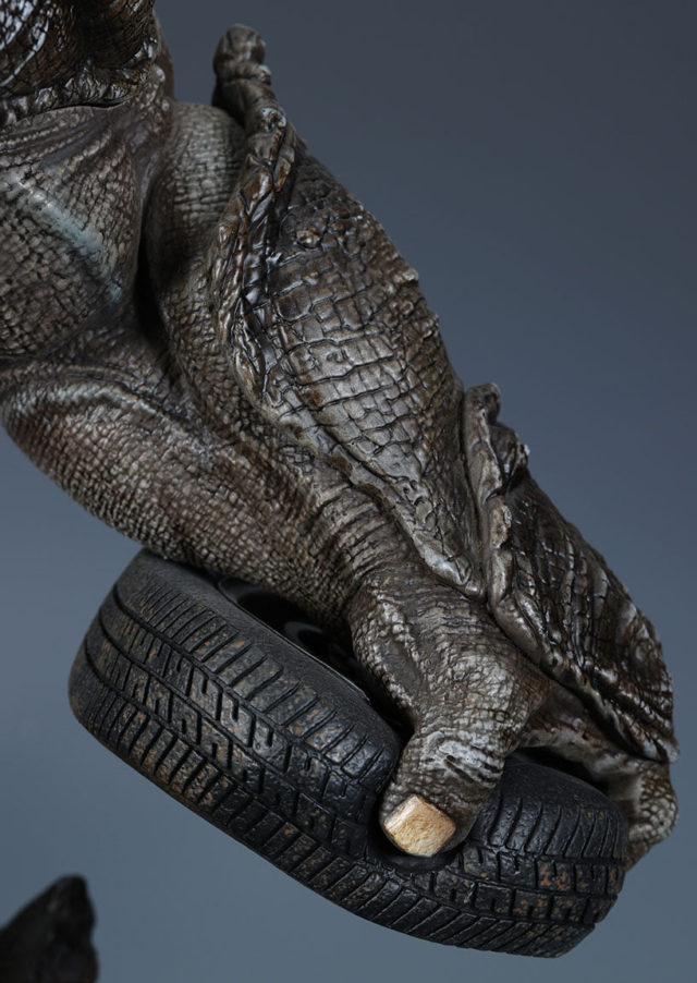 XM The Rhino Statue Holding Tire